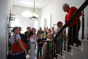 A docent leads a group tour